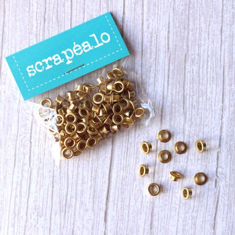 Pack de 100 eyelets metálicos dorados de Scrapéalo